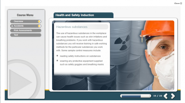 Screenshot of health and safety induction e-learning course. With a person wearing correct PPE equipment, and hazard barrels behind him in black and white.