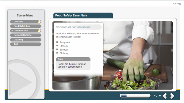 A screenshot from the food safety online course. Displaying a man with green fingers, handling salad. Highlighting the importance of contamination.